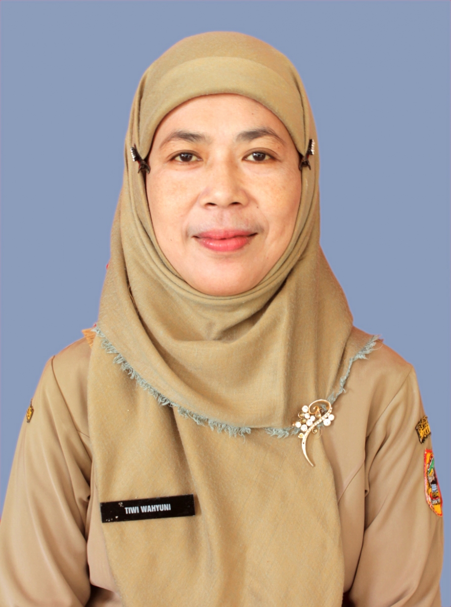 Dra. Tiwi Wahyuni